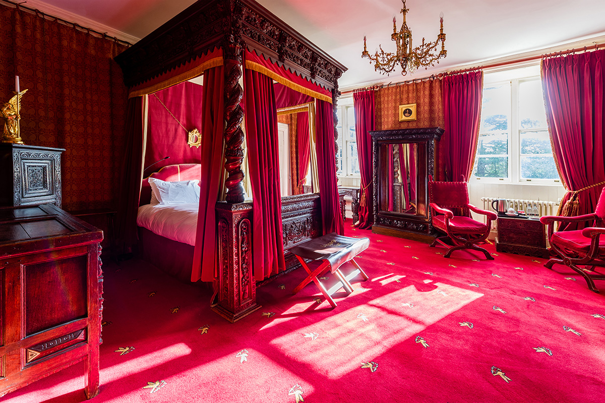 Antiques and four poster bed in the Clifford bedroom at Appleby Castle