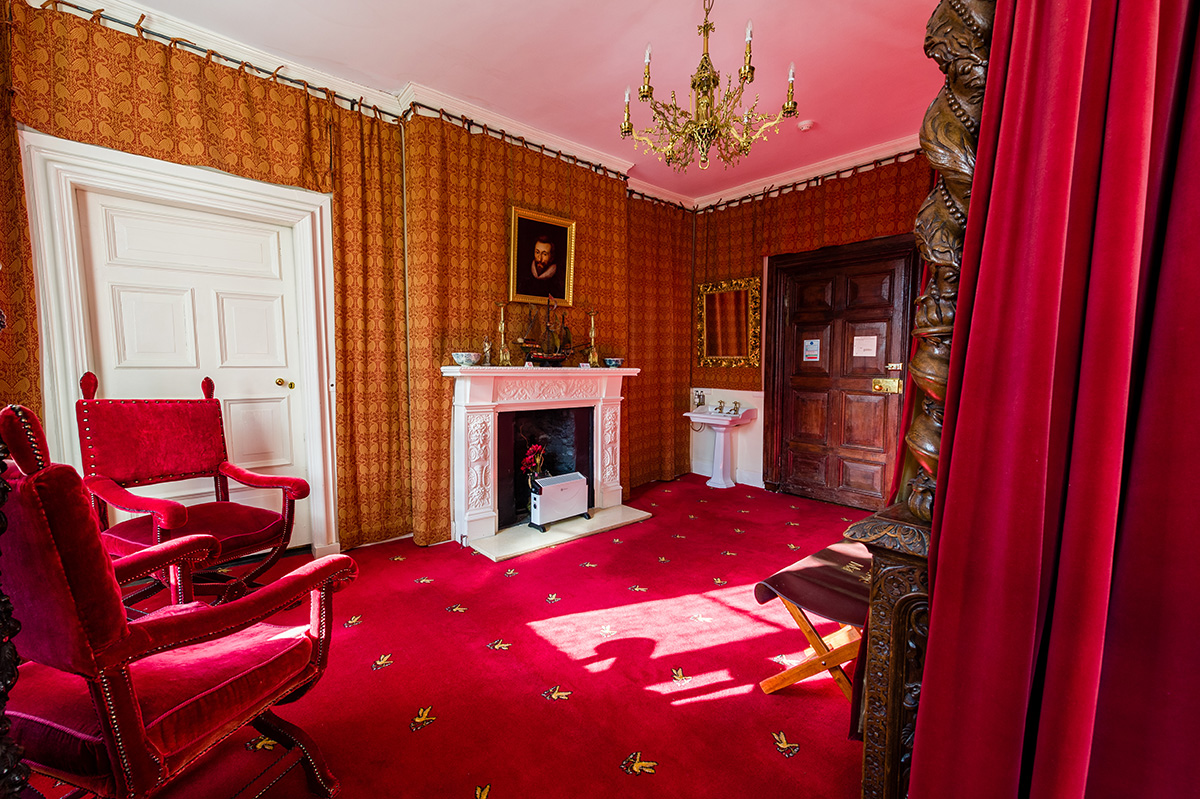 Antique chairs and wall coverings in the Clifford bedroom at Appleby Castle