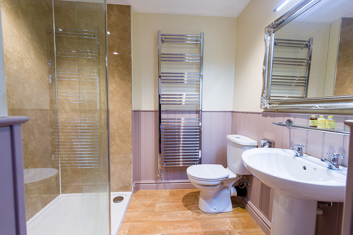 Large bathroom with sink, toilet and shower at Appleby Castle