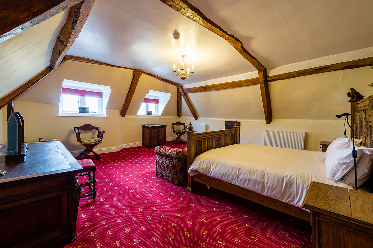 Large bed and antiques in the Russel Suite bedroom at Appleby Castle