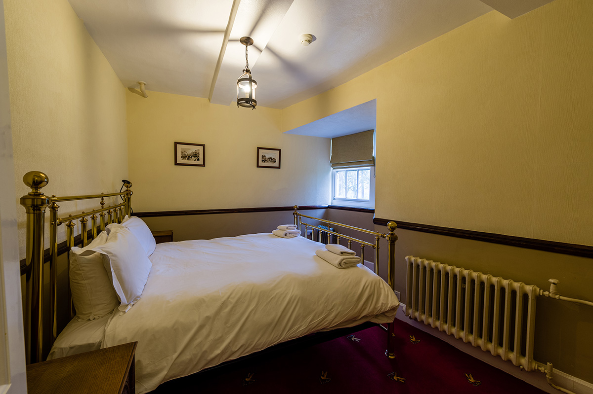 Large brass bed in the Le Meshin bedroom at Appleby Castle in Cumbria