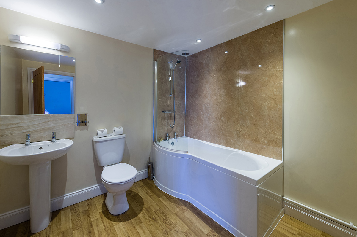 The spacious bathroom in the self-contained holiday cottage at Appleby Castle