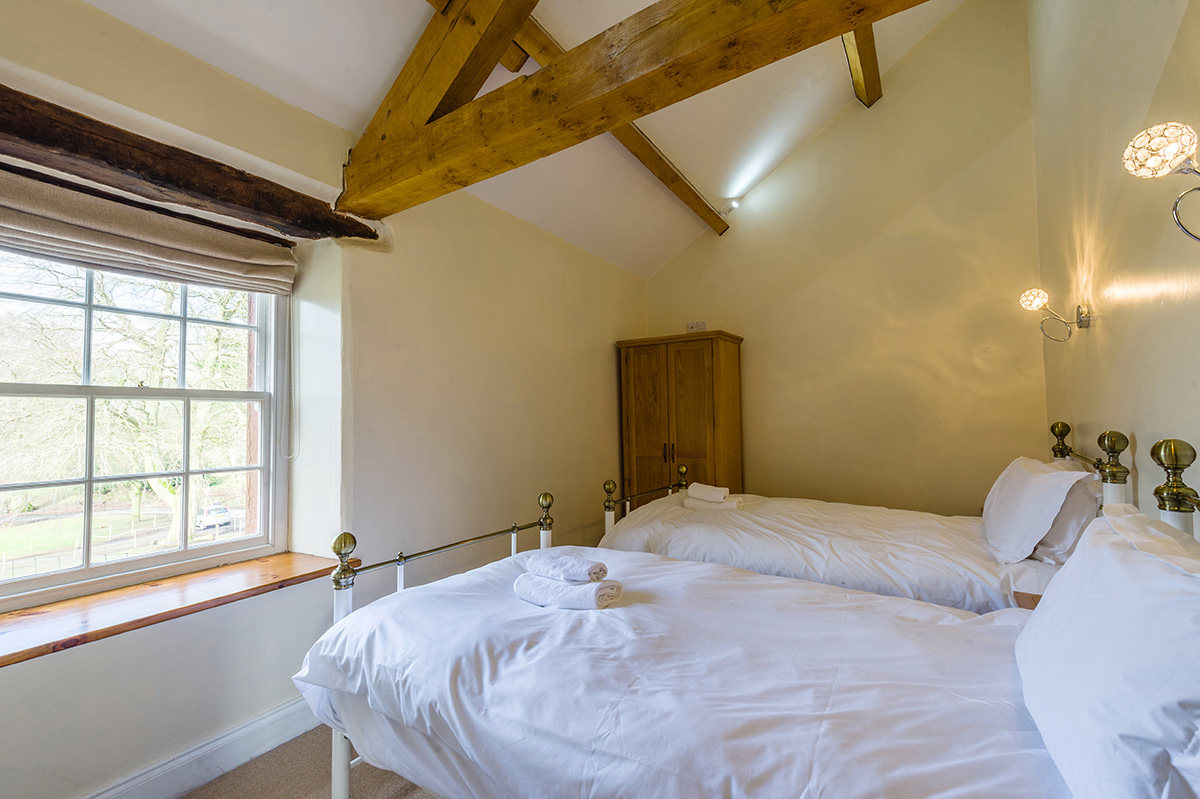 2 single brass beds in the self-contained holiday cottage at Appleby Castle