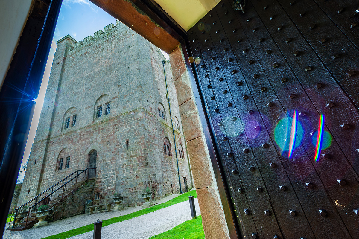 The view of Appleby Castle's Norman Keep through the self-contained holiday cottage door