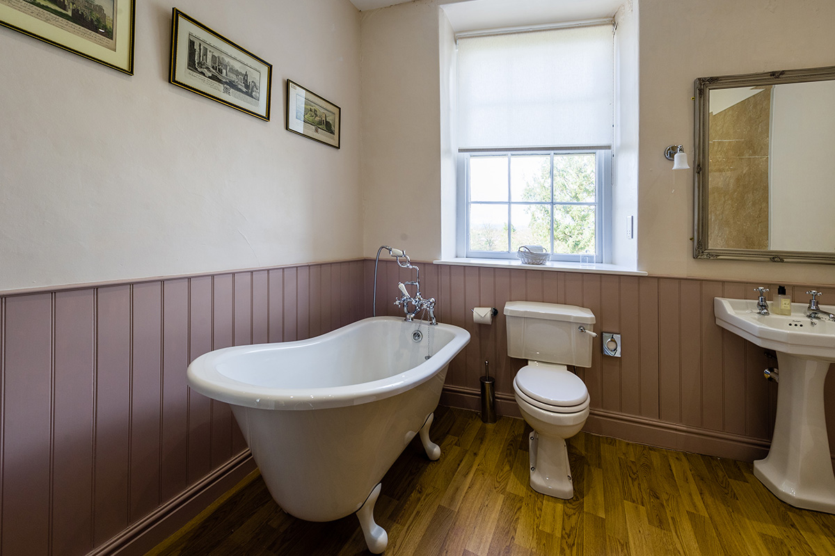 Large bathroom with bath, sink, toilet at Appleby Castle